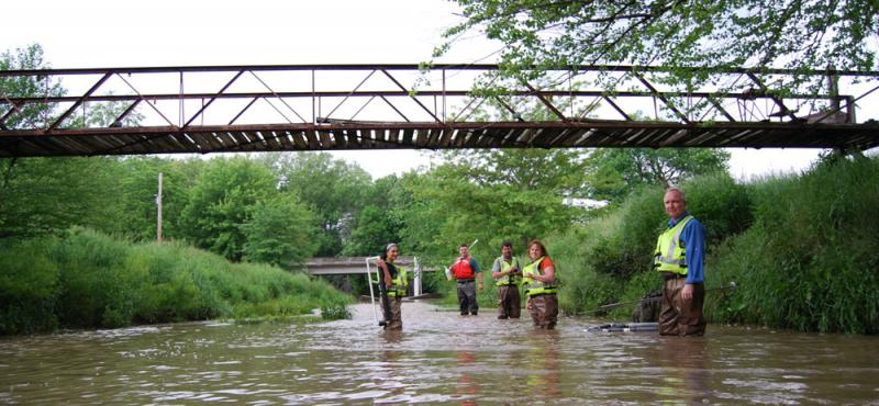 One of the U.S. Geological Survey teams collecting water samples and checking cages for fish eggs in Missouri this summer: biologist Diana Papoulias, chemist Dave Alvarez, hydrologist Peter Van Metre, biologist Diane Nicks and toxicologist Don Tillitt.