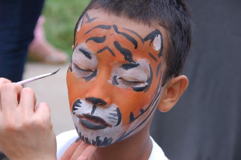 Shalamo has his face painted like a tiger at Columbia World Refugee Day.  Shalamo was most recently in Thailand before coming to Columbia.