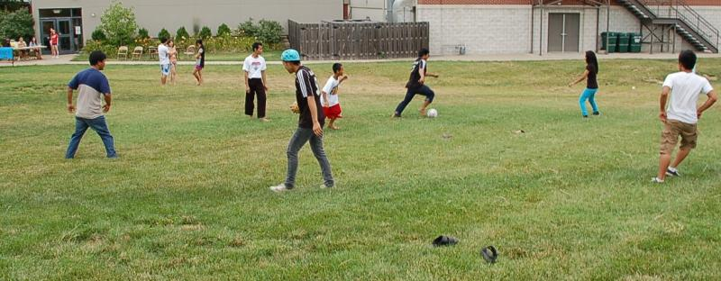 A dozen refugees from Burma play soccer outside Broadway Christian Church in Columbia on Saturday, July 20.  They were there to celebrate  Columbia World Refugee Day Festival to generate awareness about the plight of refugees around the world.