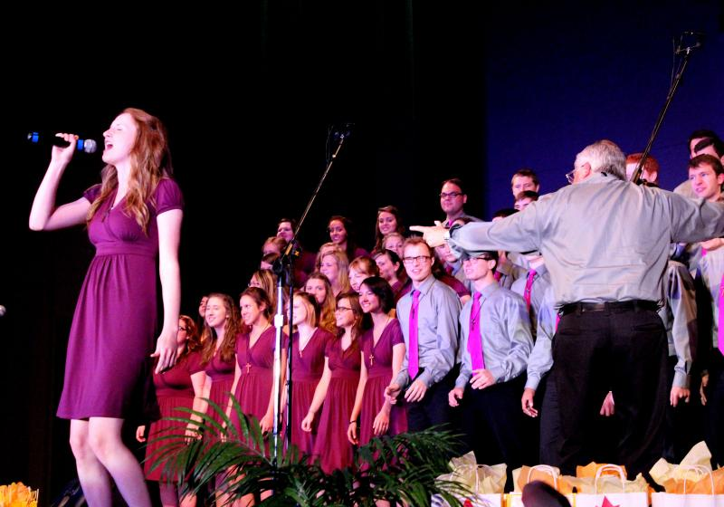 Elizabeth Goller sings a solo as musical director, Bemo Meyers, conducts the New Generation Singers.