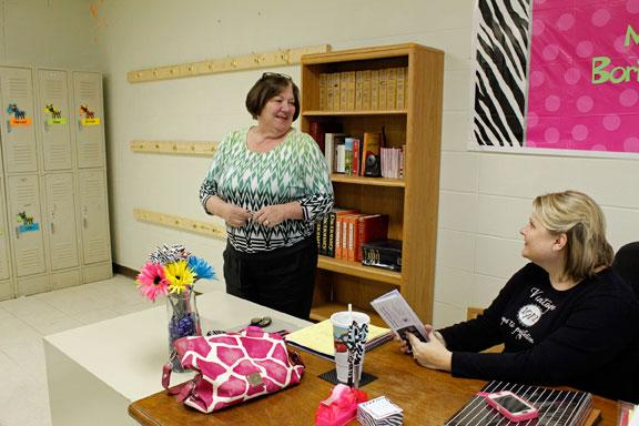 Principal Elaine Hassemer tells sixth-grade teaching Jennifer Borisenko how much she likes the bright zebra-print decorations in the classroom. Both Hassemer and Borisenko are new to the school.