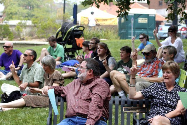 Community members gather in Flat Branch Park for an interfaith worship service.