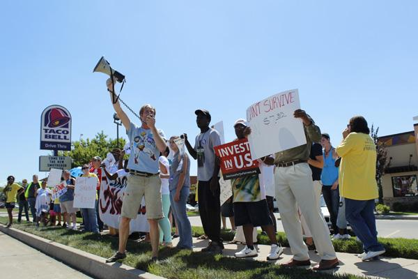 The movement for better wages also gathered outside the Taco Bell on Nifong Boulevard.