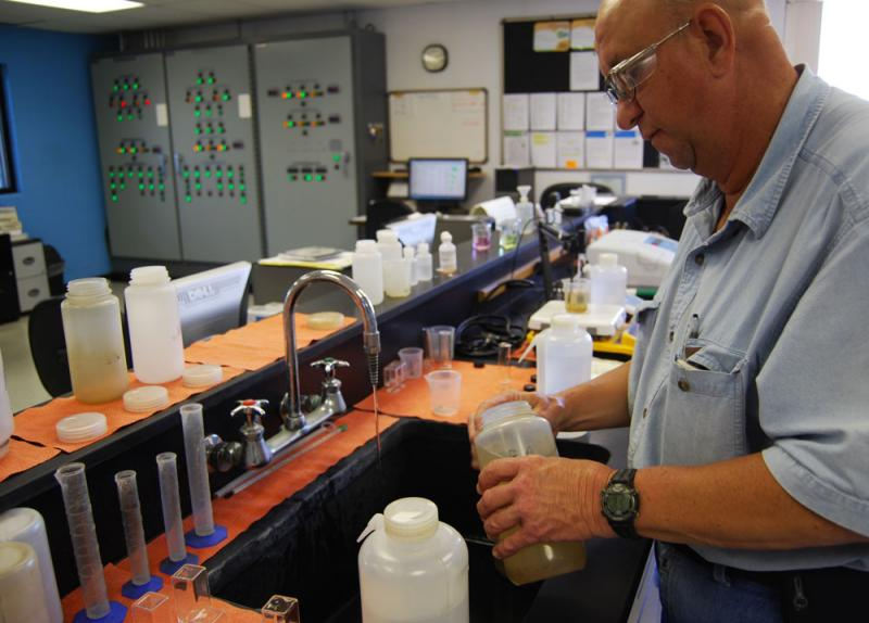 Water treatment plant operator Fred Omer gets ready to do an iron test on water samples at the Clarence Cannon Wholesale Water Commission in Stoutsville, Mo.