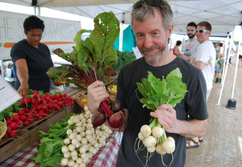Mike Odette, chef and co-owner of Sycamore Restaurant, finds beets and turnips that will make tasty refrigerator pickles at the Columbia, Mo. farmers market.