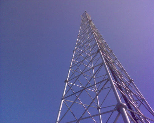 The four measures signed Thursday would limit the ways local governments impose regulations on cellphone towers.