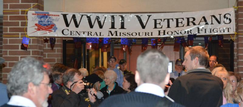 A banner welcoming World War II veterans is displayed at the entrance of the Marriott Hotel on Tuesday, Oct. 15, 2013 in Columbia, Mo. Veterans from World War II, the Korean and Vietnam Wars visited national memorials in Washington earlier that day.