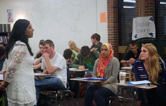 From left, John Rohmiller, 17; Inas Syed, 17; and Haley Benson, 17, all seniors at Rock Bridge High School, listen to a guest lecture from Punam Sethi. Sethi is a practicing Hindu and came to the class to guest lecture.