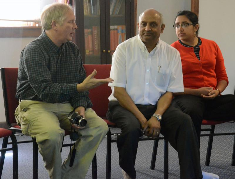 George Frissell speaks to Vellore Gopalaratnam and his daughter, Adithi Gopalaratnam at Shanthi Mandir in Columbia on a Saturday.  Frissell brought his world religions class from Hickman High School to the temple as part of their discussion of Hinduism.