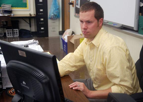 Greg Irwin checks his computer on a Monday morning at Rock Bridge High School in Columbia. Irwin is the world religions teacher at Rock Bridge, and the course is being offered for the first time this year.