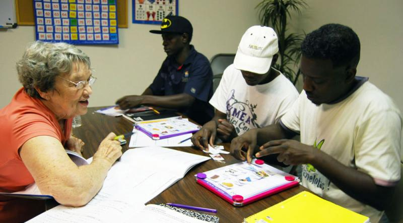 Sudanese refugees who work at the Tyson plant get English language instruction.