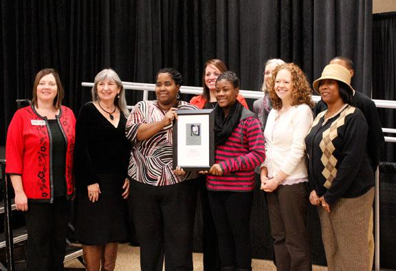Mayor Pro Tem Barbara Hoppe poses with staff from Ulysses S. Grant Elementary School, the group winner of the 2014 Columbia Values Diversity Award.