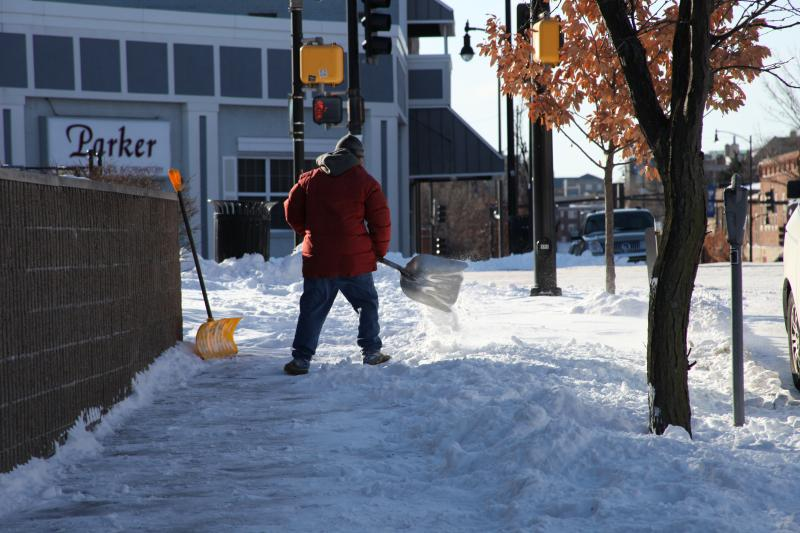Shoveling snow on 10th Street in Columbia, Mo.