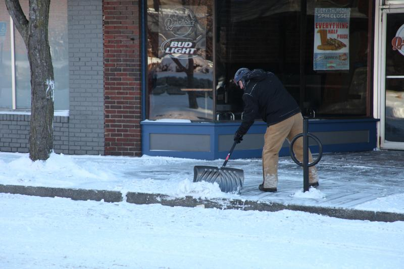Clearing the sidewalk outside of Quinton's in Columbia, Mo.