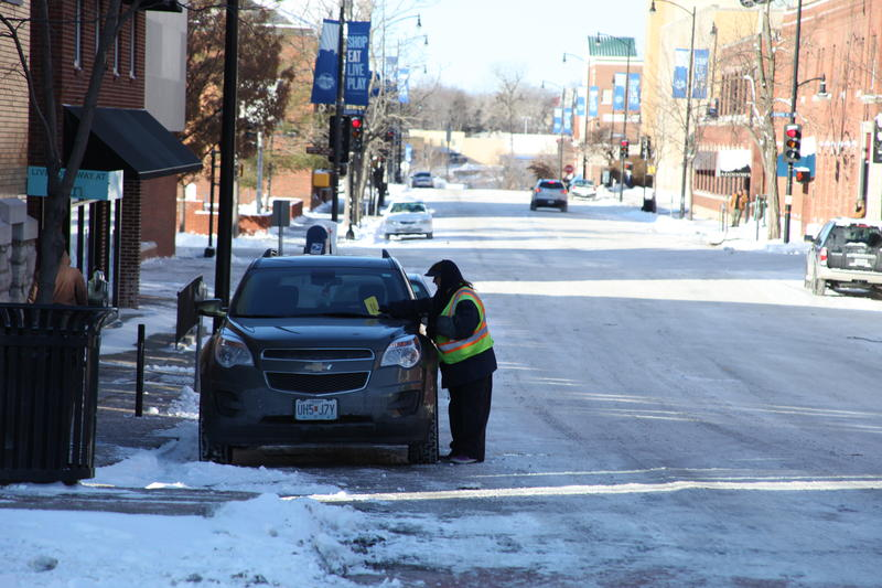 Despite the frigid temperatures and snowfall, parking tickets are still being handed out to cars in downtown Columbia.