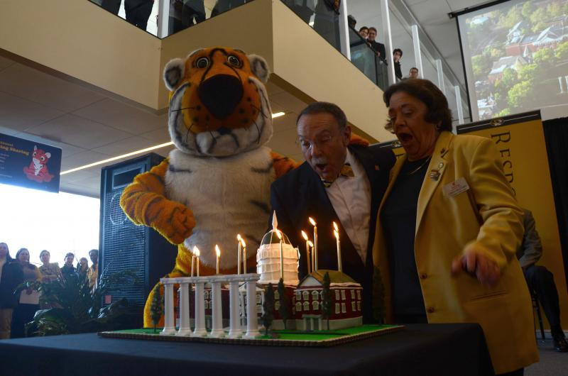 Truman the Tiger, MU Chancellor R. Bowen Loftin, and Cindy Mustard, director of Columbia's Voluntary Action Center, blow candles during MU's 175th birthday celebration.