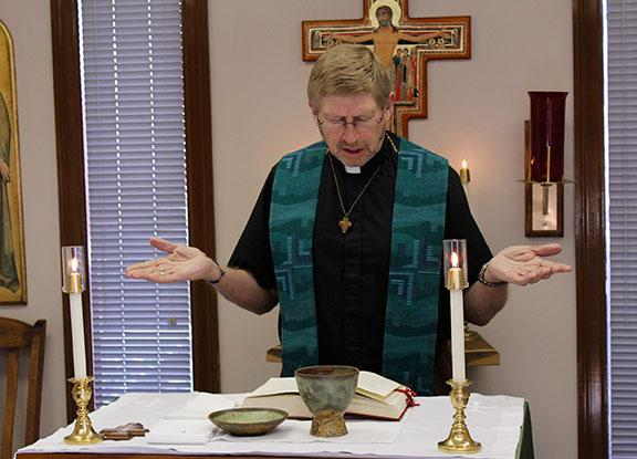 Fr. John Prenger leads a midday liturgy at the Chapel of Saints Francis and Clare, which is part of the Charismatic Episcopal Church.