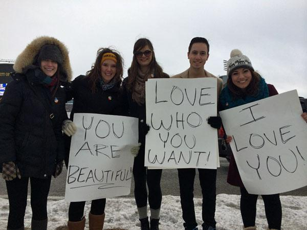 A group of students hold signs in support of MU football player Michael Sam, who recently came out as gay. The students were part of a counter-protest, in response to Westboro Baptist Church.