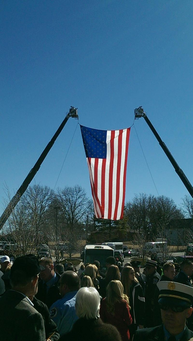 A flag waves over the memorial service for Lt. Britt held at The Crossing Thursday morning. Lt. Britt was buried with full figherfighter honors.