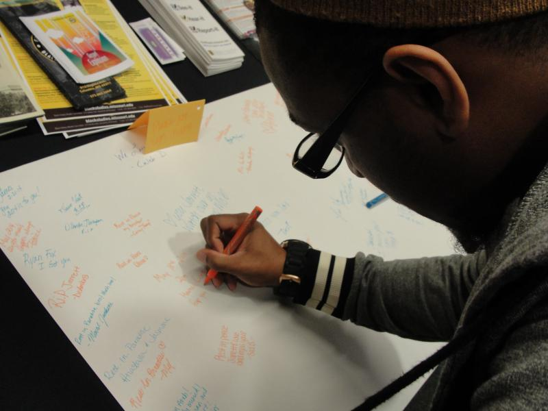 Friends, family and fellow students wrote messages for Mosby at the service in Columbia, MO February 21, 2014