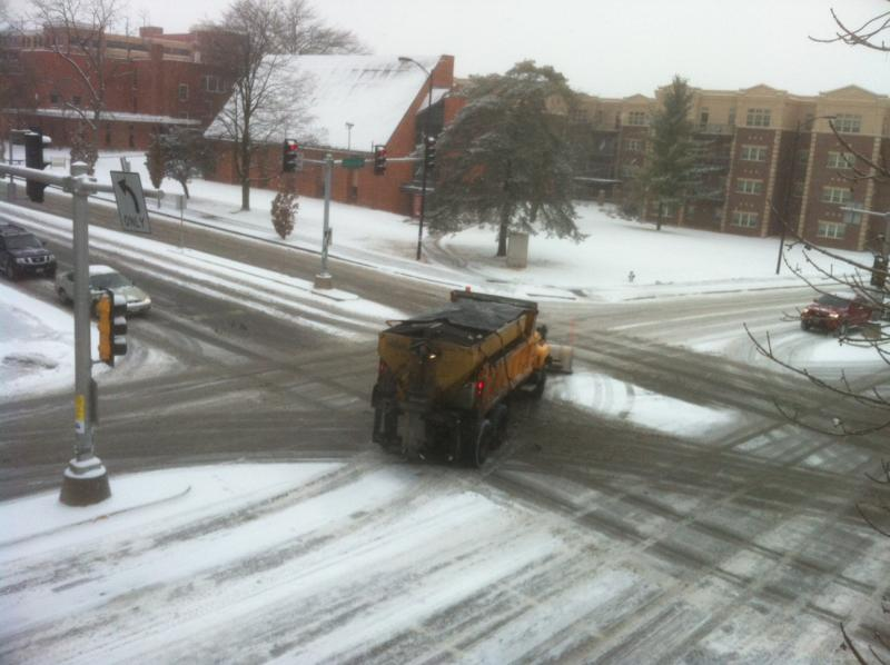 A plow passes through the intersection of College and Broadway, in downtown Columbia, Tuesday morning.
