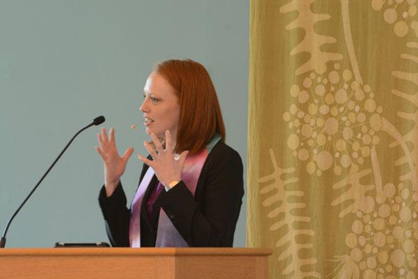 The Rev. Molly Housh Gordon describes the importance of giving back to the community during her homily one Sunday at the Unitarian Universalist Church.