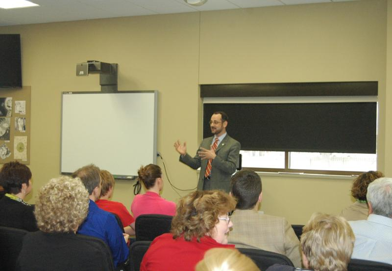 """Dr. Peter Stiepleman addresses the public during Tuesday night's """"Meet and Greet"""" event at the Columbia Public Schools administrative building. Stiepleman currently works as the Columbia Public Schools assistant superintendent of elementary education."""