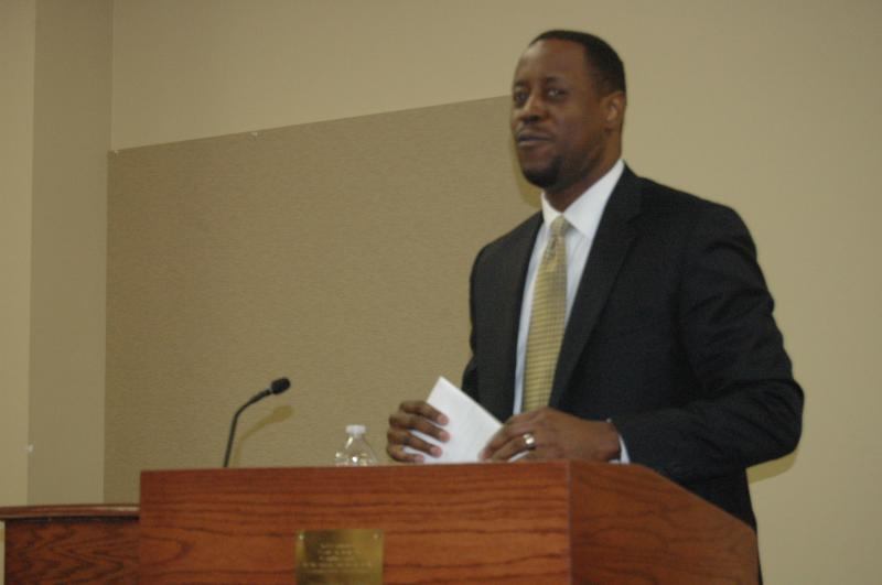 """Dr. Dred Scott speaks during Tuesday night's """"Meet and Greet"""" event at the Columbia Public Schools administrative building. Scott currently works as the deputy superintendent of Independence School District in Independence, Mo."""