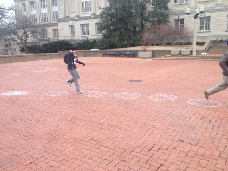 "A runner attempts the ""Ultimate Hopscotch"" portion of the True Life Run on Saturday, March 1, 2014. This twist to the race took place at Lowry Mall on the MU campus."