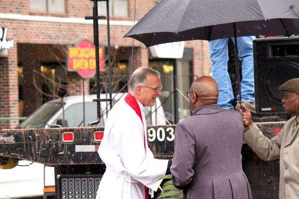 The Rev. Knute Jacobson of Calvary Episcopal Church greets the Rev. Clyde Ruffin of Second Missionary Baptist Church before the ecumenical Blessing of the Palms on April 13, 2014.