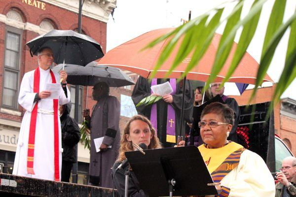 The Rev. Linda Stewart of Second Missionary Baptist Church prepares to lead a song at the ecumenical Palm Sunday service on April 13, 2014.