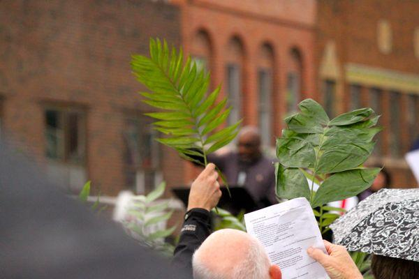 The Rev. Clyde Ruffin of Second Missionary Baptist Church leads the Blessing of the Palms portion of an ecumenical service on April 13, 2014.