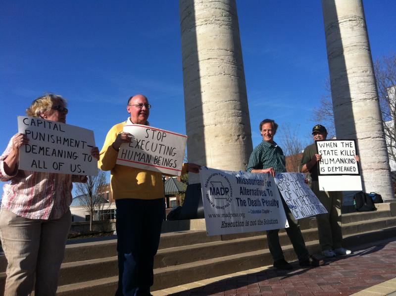 Members of Missourians for Alternatives to the Death Penalty held a vigil Tuesday, April 22, 2014, on the eve of William Rousan's execution.