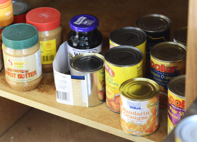 Canned foods from the food bank sit in the Clark's pantry in the kitchen of their Sedalia, Mo., home on Monday, April 21, 2014. Christie Clark said that they regularly go to the Open Door Food Pantry in Sedalia, but that the selection is not always ideal.