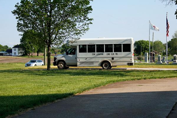 The Zion Lutheran School bus prepares to drive from Zion Lutheran Church, where students had chapel, back to the school. The church and school are down the road from each other.