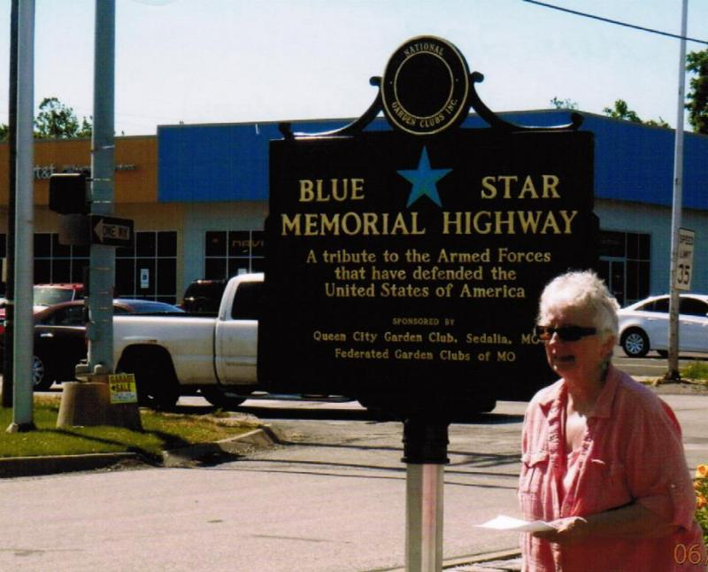 Sedalia's Donna Freese hands out literature near a Blue Star Memorial. the plaques are located nationwide as a way to remember veterans' service.