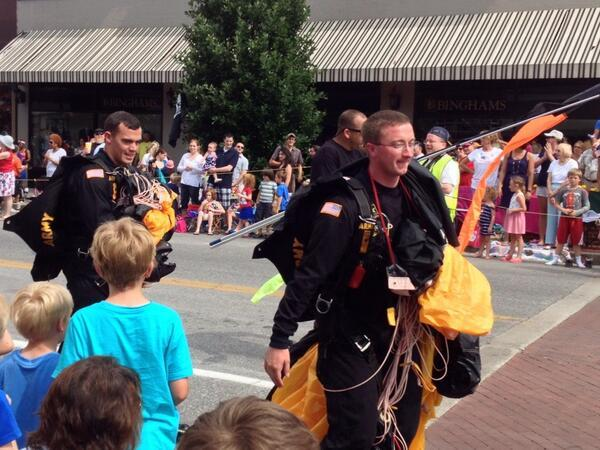 Members of the United States Golden Knights Demonstration team walk along the parade route after parachuting into the intersections on Broadway in downtown Columbia on May 26, 2014.