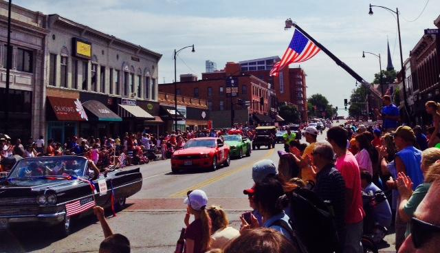 The crowd applauds as the 26th annual Salute to Veterans Memorial Day Parade takes place on Broadway in downtown Columbia on May 26, 2014.