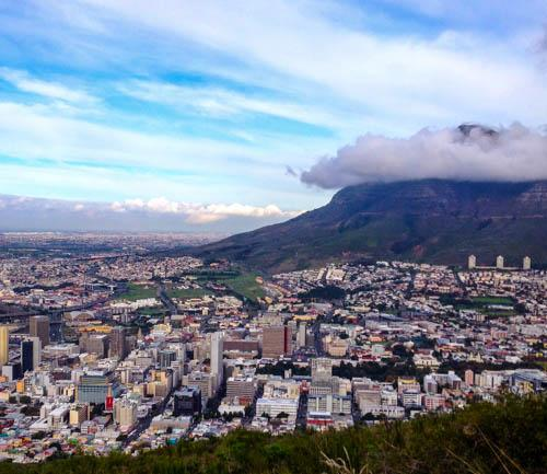 Devil's Peak, right, is one of the mountains that form a dramatic backdrop to Cape Town, South Africa's second-most populous city. Originally settled by the Dutch as a naval ship supply station, Cape Town today has a population of roughly 3.7 million and