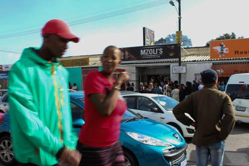 Every Sunday, Mzoli's hosts a food and music street party at Cape Town's Guguletu Township. The event draws residents from the township as well as Cape Town residents and tourists.
