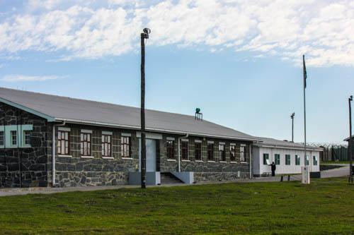 Some of the former prisoner housing quarters at Robben Island. Today, the island is a popular tourist attraction and has been declared a national heritage site for South Africa. In 1999, UNESCO declared it a World Heritage Site.