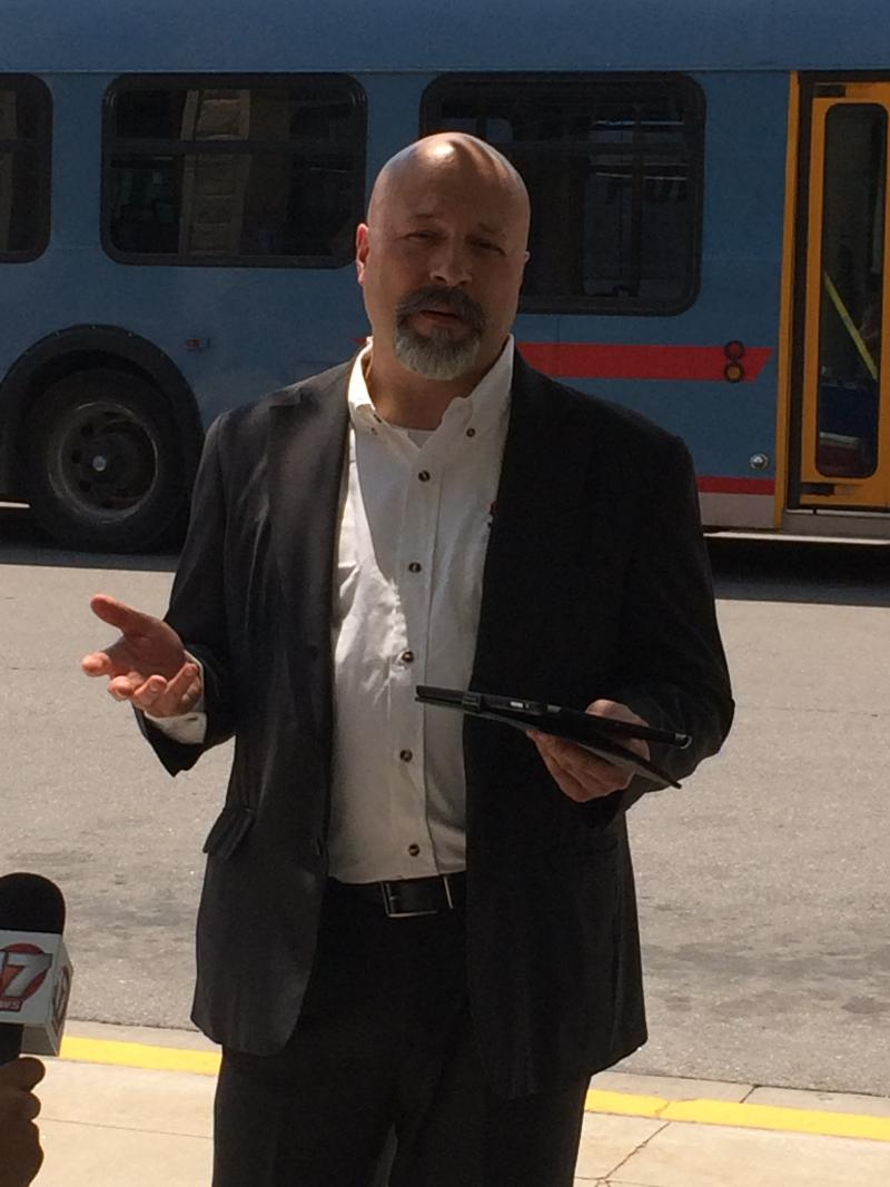 "COMO Connect Multi-Modal Manager Drew Brooks talked to reporters Tuesday at a ribbon cutting ceremony for Columbia's new public transit system ""COMO Connect"" in Columbia, Mo."