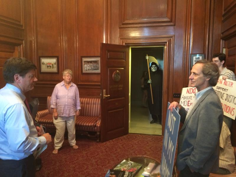 The Mid-Missouri Fellowship of Reconciliation gathered in the governor's office reception room in Jefferson City, Mo on June 16, 2014. to present the award to Missouri Gov. Jay Nixon for supporting the death penalty. Eight inmates have been executed durin