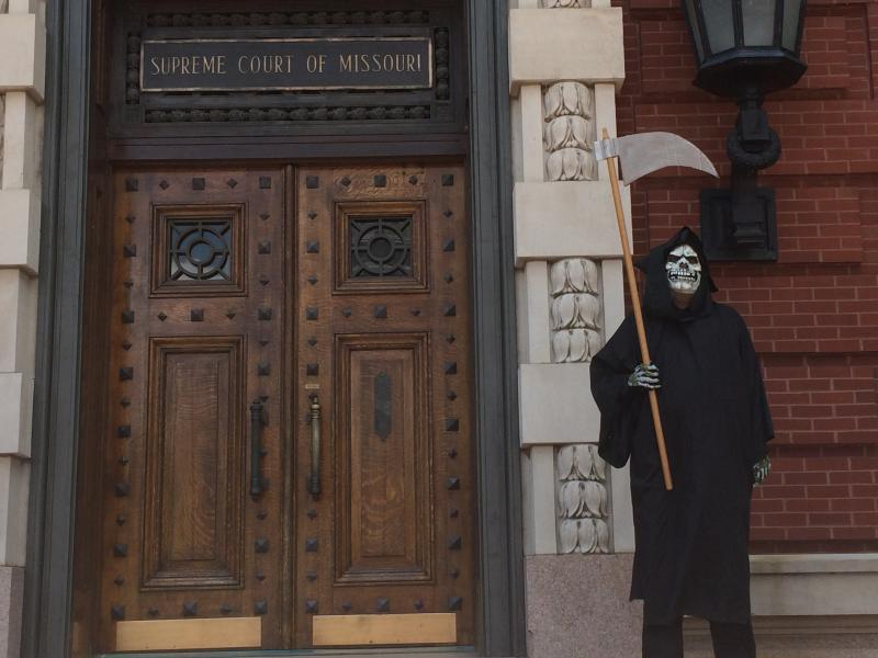 A man dressed as the grim reaper stands in front of the Missouri Capitol building in Jefferson City, Mo. on June 16, 2014. The Mid-Missouri Fellowship of Reconciliation was protesting the scheduled execution of John Winfield. Winfield might be the 75th pe