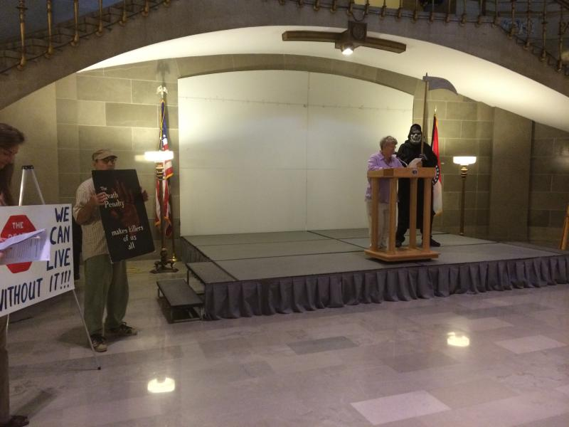 The Mid-Missouri Fellowship of Reconciliation carried signs and conducted a skit in the Missouri Capitol rotunda in Jefferson City, Mo on June 16, 2014. On Tuesday, a panel of three judges upheld the stay of John Winfield's execution, which was scheduled