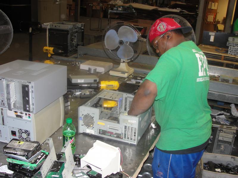An employee at EPC's west St. Louis County facility breaks down a computer for parts that can be recycled.