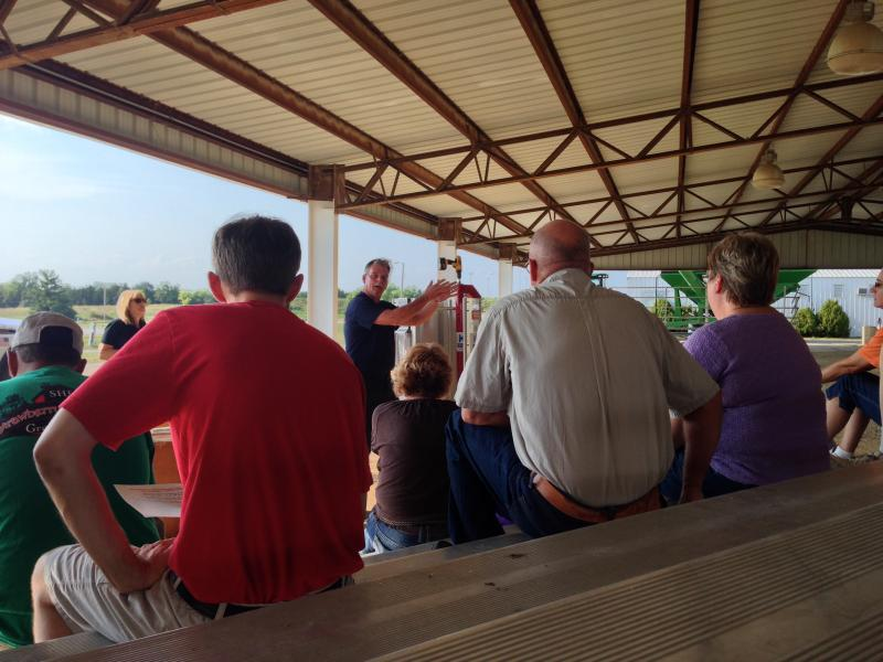 Assistant Chief Doug Westhoff of the Boone County Fire Protection District talks with local farmers about grain bin safety.