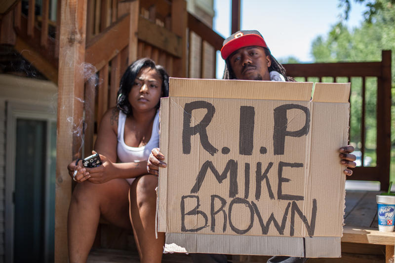 Tanesha Nesbitt and Terran Tippett across the street from where Michael Brown was killed
