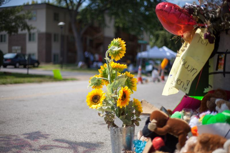 Flowers adjacent to a community memorial where Michael Brown was shot