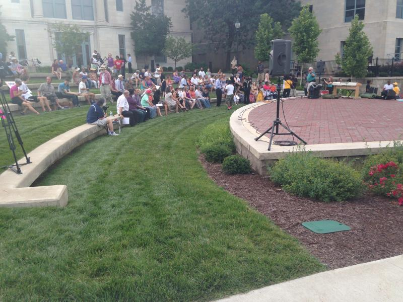 Demonstrators file into rows at the amphitheater near the Boone County Courthouse